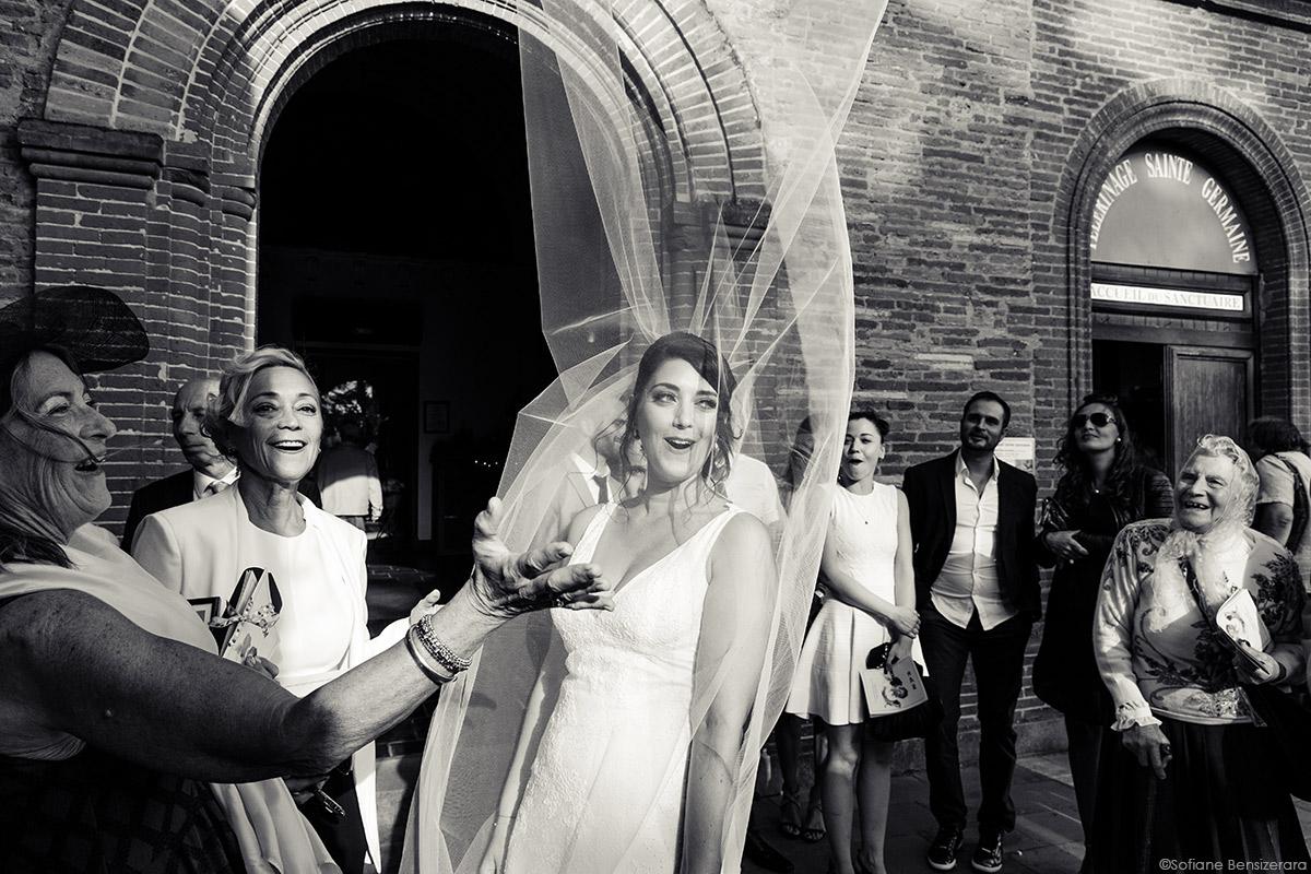 photo unique mariage vent voile mariee
